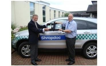 Chris Jones presents Allan Lowe with the Defibrillator